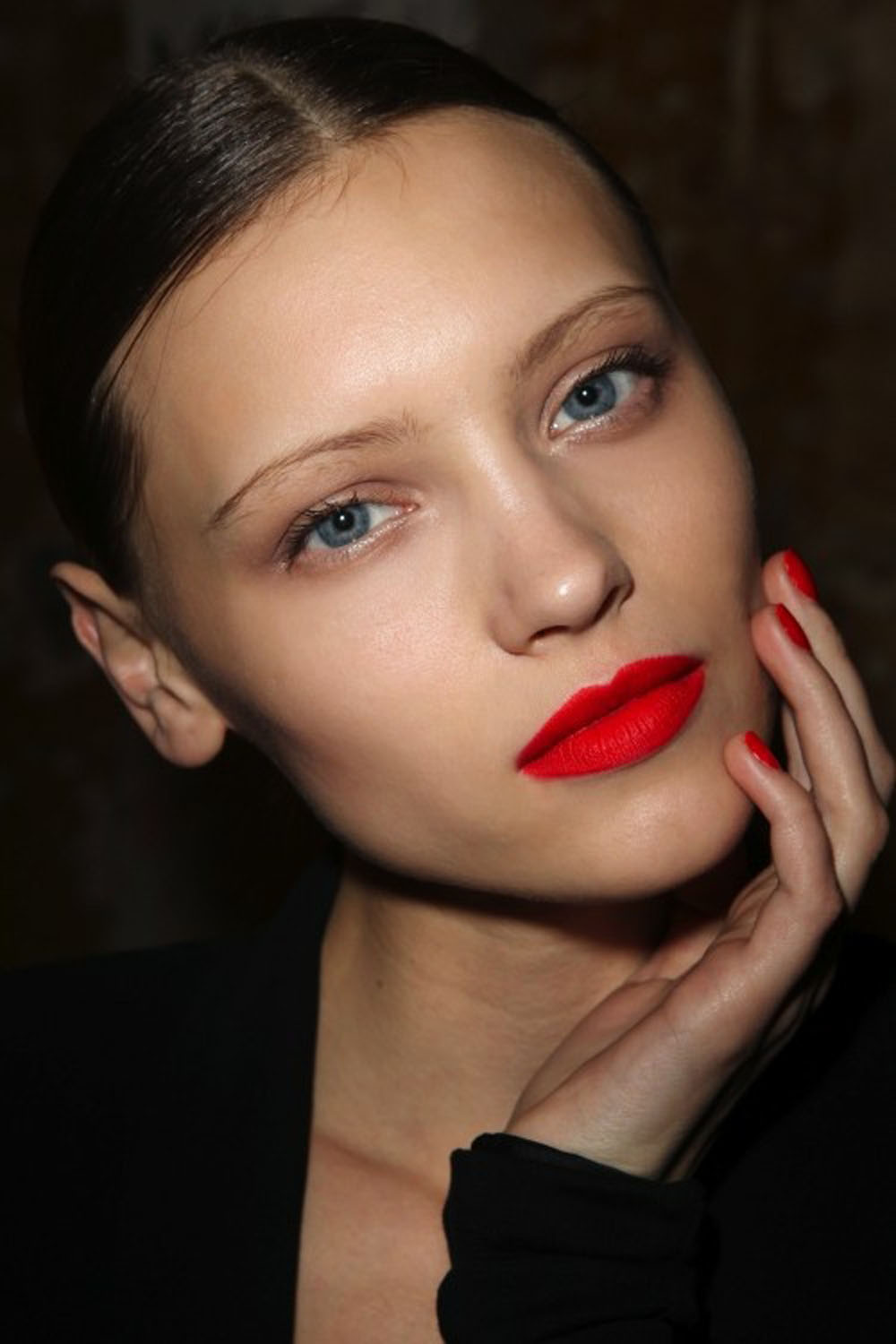 Red lipstick is a statement look, as eye-catching as a big necklace or jeweled neckline. To make it work, keep the rest of your face simple and fresh. A little concealer, a coat of mascara and a swipe of red on your lips is a bold and timeless style.